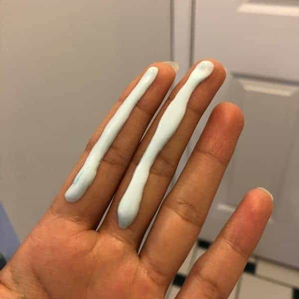 2 finger sunscreen rule, index and middle fingers with a line of sunscreen on each